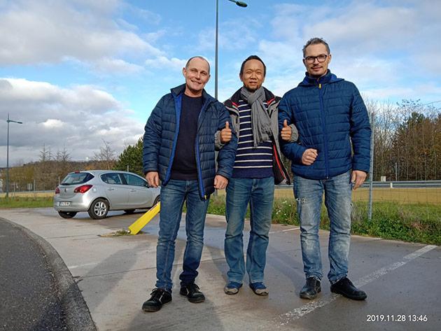 Alain Boulange(左);车手赵建军(中);Guillaume Murat(右)